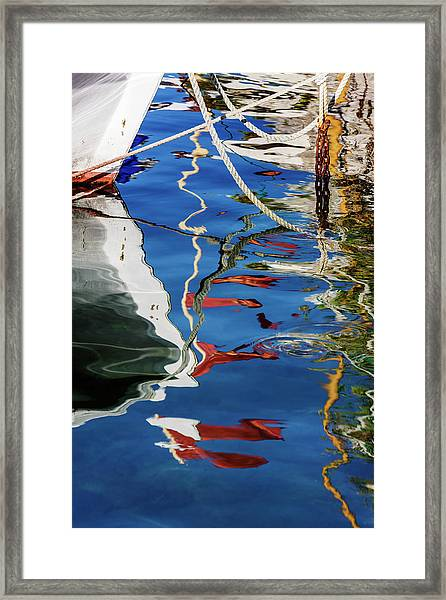 Reflections Of Boats In Harbor Framed Print