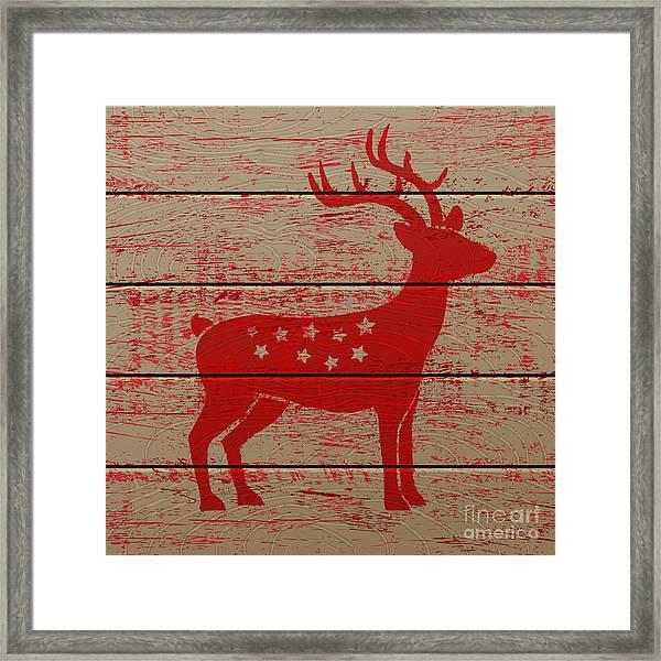 Reindeer On Old Wooden Background Framed Print