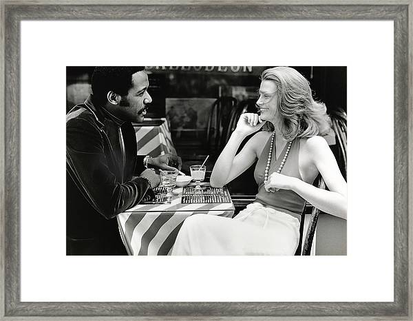 Richard Roundtree And Model At Cafe Framed Print