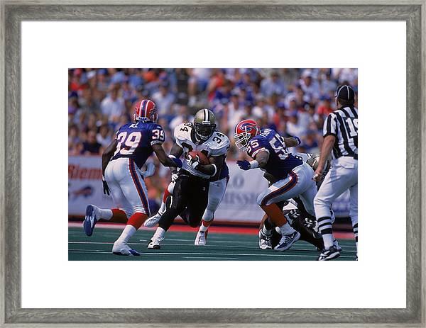 Ricky Williams #34, Jay Foreman #55, Raion Hill #39 Framed Print by Rick Stewart