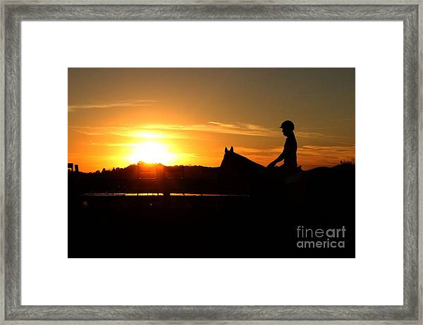 Riding At Sunset Framed Print