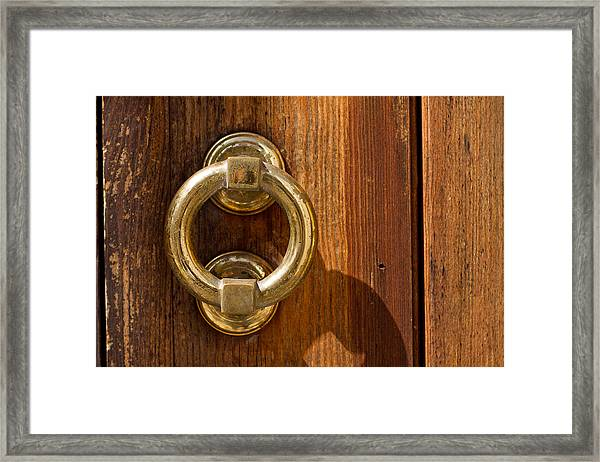 Framed Print featuring the photograph Ring On The Door by Raimond Klavins