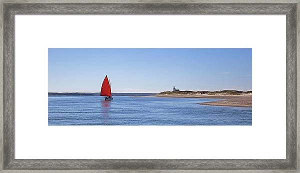Ripple Catboat With Red Sail And Lighthouse Framed Print