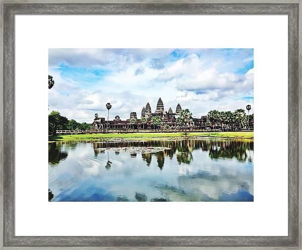 River By Angkor Wat Against Sky Framed Print