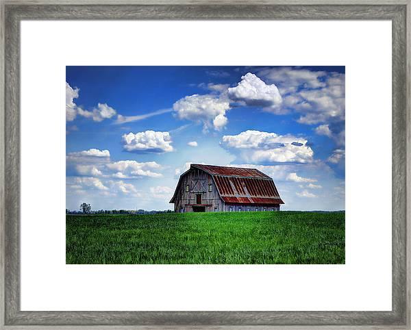 Riverbottom Barn Against The Sky Framed Print