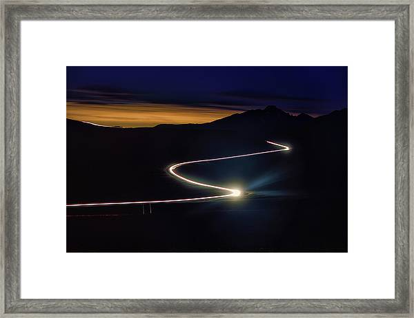 Road With Headlights In Rocky Mountain Framed Print