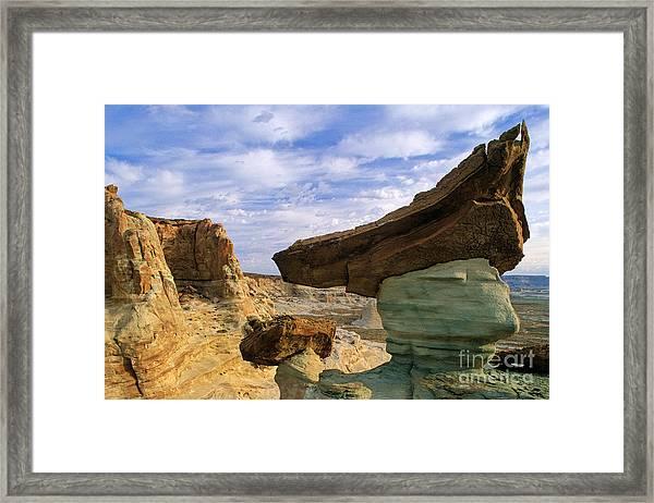 Rock With Triangular Hat Framed Print