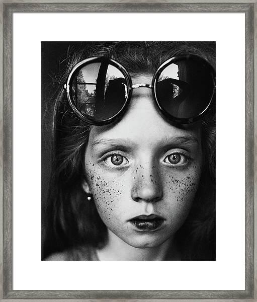 Round Glasses Reflection Framed Print