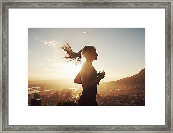Run With The Sun Framed Print by PeopleImages