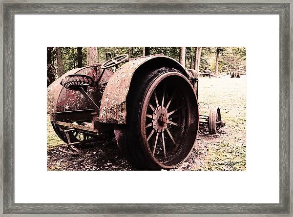Rusted Big Wheels Framed Print