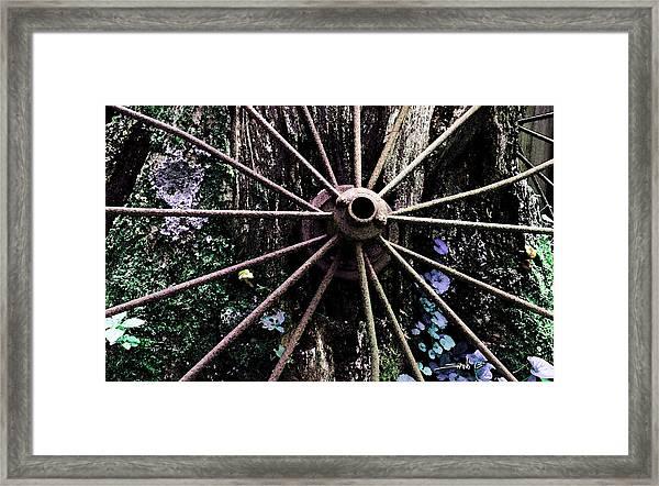 Rusted Spokes Framed Print