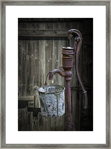 Rusty Hand Water Pump Framed Print