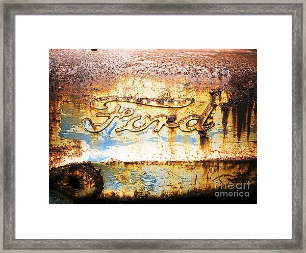 Framed Print featuring the photograph Rusty Old Ford Closeup by Edward Fielding