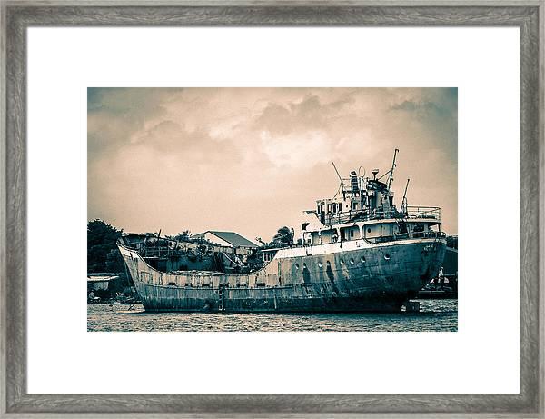 Rusty Ship Framed Print