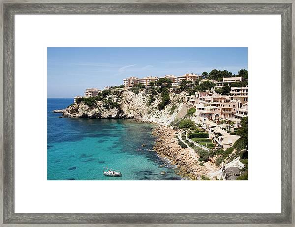 Sailboat And Coastline Framed Print