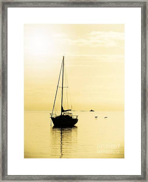 Sailboat With Sunglow Framed Print
