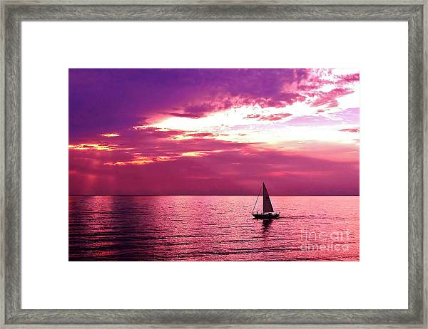 Sailing Into The Setting Sun Framed Print