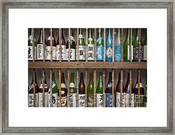 Sake Bottles Framed Print