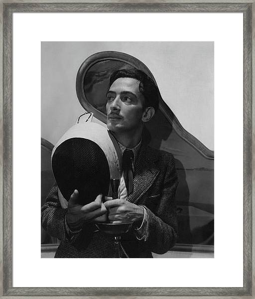 Salvador Dali Holding Fencing Equipment Framed Print