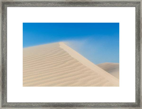 Sand Blowing Off A Dune Framed Print