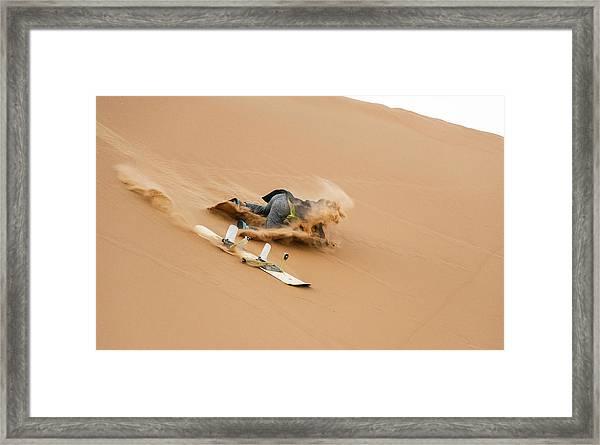 Sand-boarding The Saharan Sand Dunes, Merzouga, Morocco Framed Print by Paul Biris