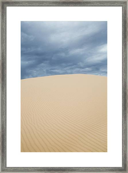 Sand Dunes And Dark Clouds Framed Print