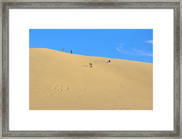 Sand Surfing In The Dunes Near Huacachina, Peru Framed Print by Markus Daniel