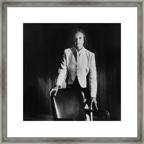 Sandra Day O'connor Posing Beside An Office Chair Framed Print by Horst P. Horst
