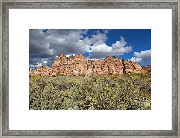 Sandstone And Clouds In Zion Natl Park Utah Framed Print by Yva Momatiuk John Eastcott