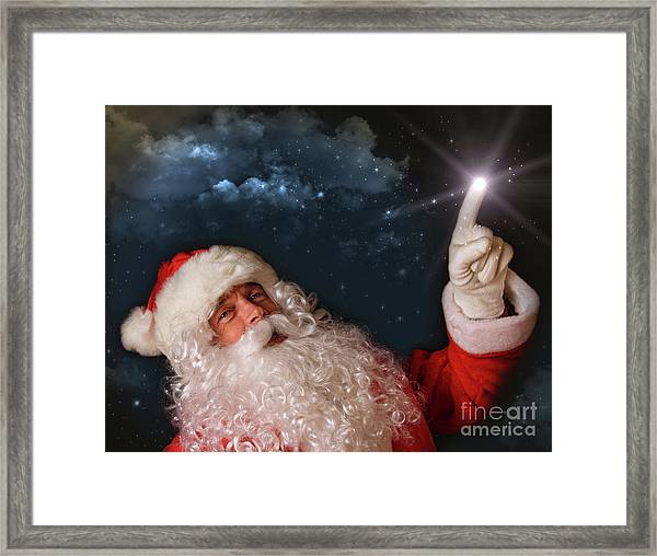 Santa Pointing With Magical Light To The Sky Framed Print