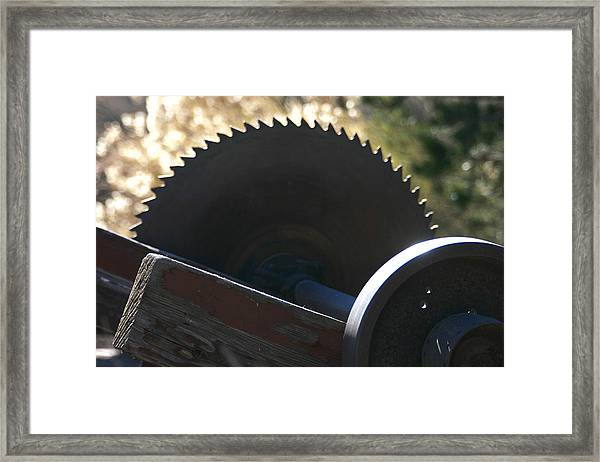 Saw Framed Print