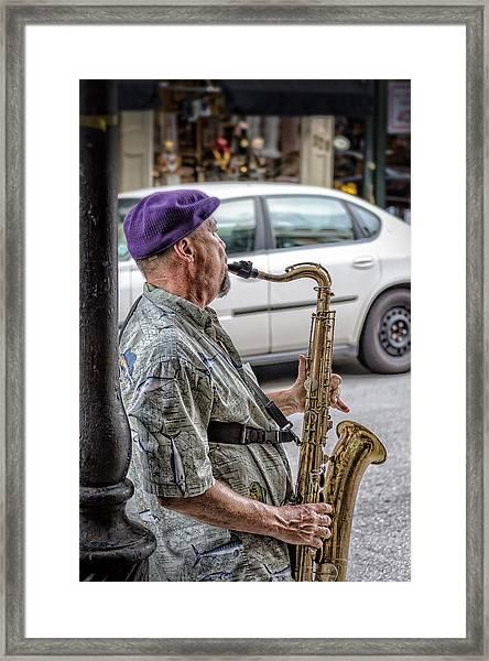 Sax In The Street Framed Print