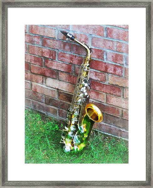 Saxophone Against Brick Framed Print