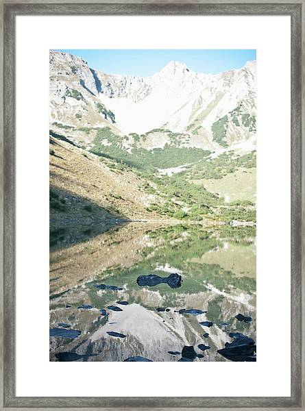 Scenic View Of Mountains And Lake Framed Print by Mark Gerum