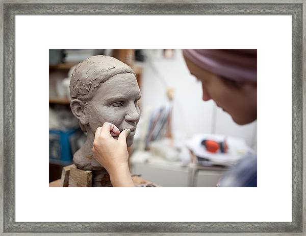 Sculptor Working On Head Sculpture Framed Print by Guido Mieth