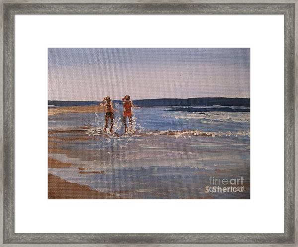 Sea Splashing On The Beach Framed Print