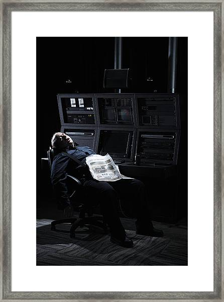 Security Guard Asleep In Office Framed Print by Thomas Northcut