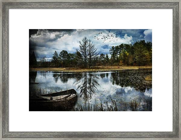 Seney And The Rowboat Framed Print