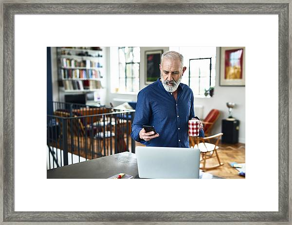Senior Creative Professional Remote Working And Checking Phone At Home Framed Print by 10'000 Hours
