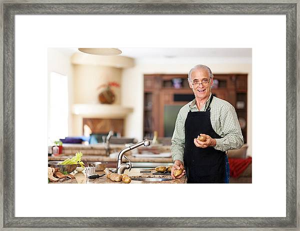 Senior Man Preparing To Wash Potatoes Framed Print by Lise Gagne