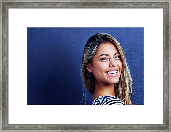 She'll Turn Your Frown Upside Down Framed Print by Yuri_Arcurs
