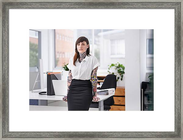 She's Ready To Rock The Corporate Scene Framed Print by PeopleImages