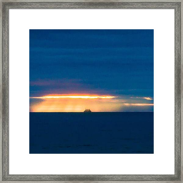 Ship On The Horizon Framed Print
