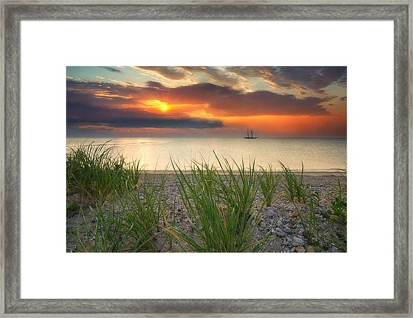 Ship Passing Through Framed Print