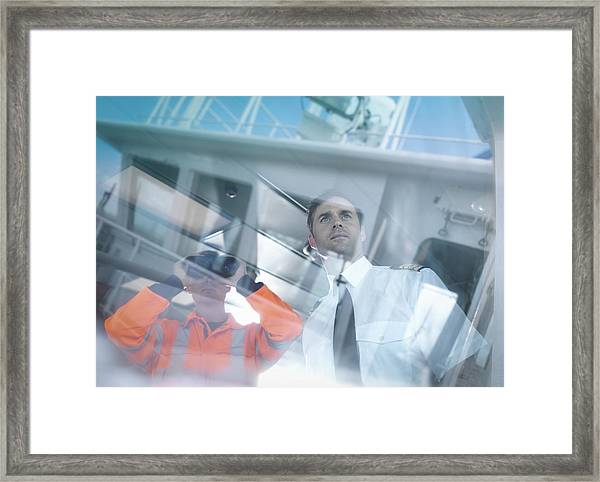 Ships Captain And Worker Seen Through Reflections On Container Ship Framed Print by Monty Rakusen