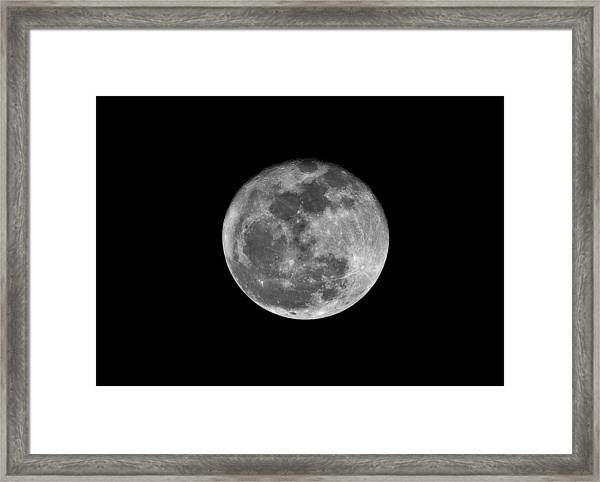 Shooting The Moon Framed Print