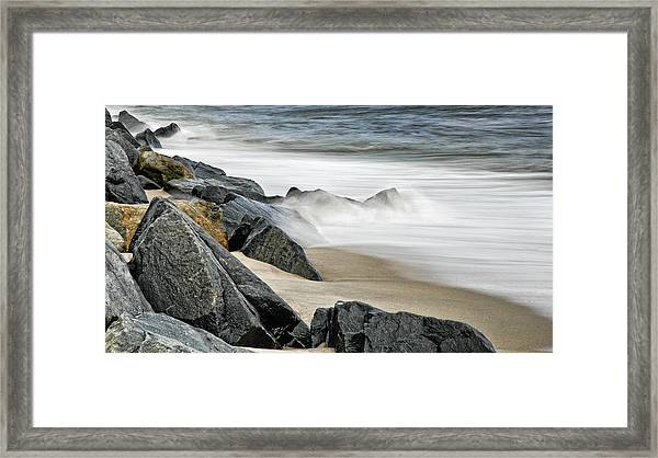 Shoreline Rocks And Opposing Surf Framed Print