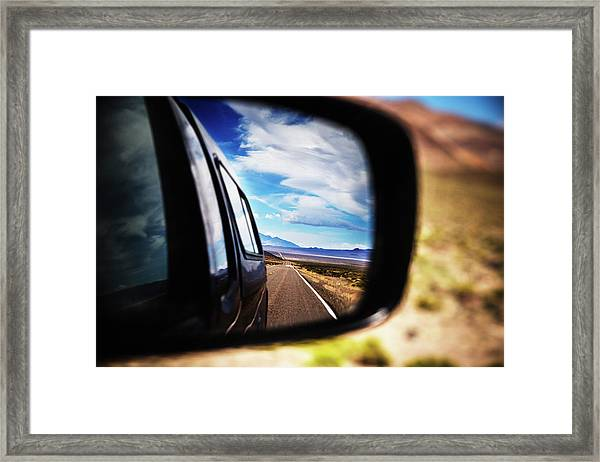 Side View Mirror Of Car Driving On Road Framed Print
