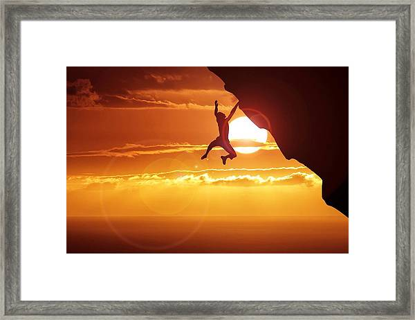 Silhouette Man Hanging On Cliff Against Framed Print