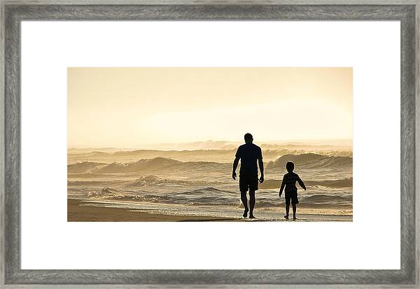 Silhouetted Father And Son Walk Beach  Framed Print